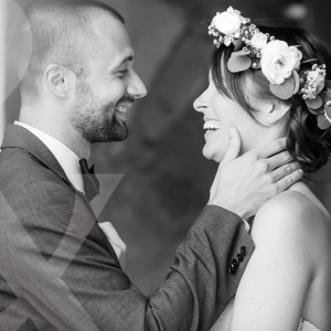 a bride and groom face one another