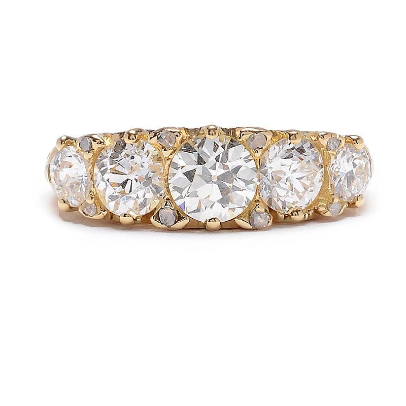 Circa 1900 Five Diamond ring in yellow gold
