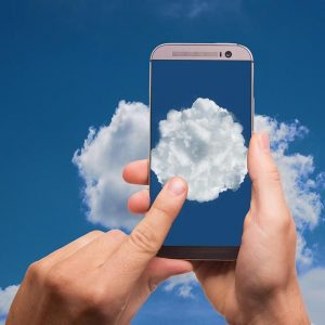 Smartphone shown photographing a cloud
