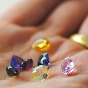 Multicolored Pavé Jewelry Sapphires held in a hand