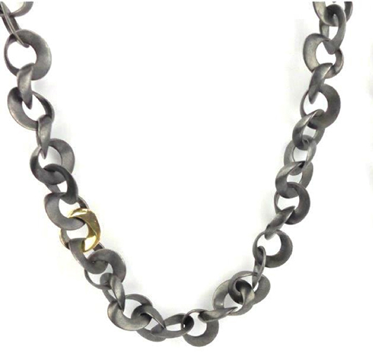 Somers Mobius necklace in oxidized silver with a 14k gold link