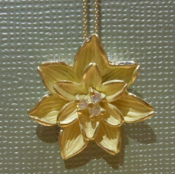 Gold Birth Flower pendants from Joseph Giovanni