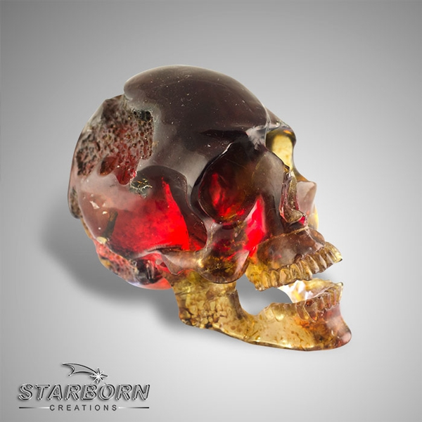 Starborn Creations carved blue amber skull