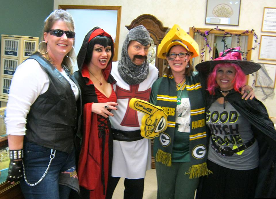 Staff at Blase DeNatale Jewelers in Forked River, N.J.: from left, Christine Feci Lindsay as a biker, Michelle DeNatale as a vampire, Blase DeNatale as a knight from Monty Python's The Quest for the Holy Grail, and Darlene Naylor Buonomo as a witch