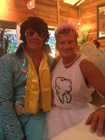 Dan Schuyler, co-owner of Lily & Company Jewelers in Sanibel, Fla., as the Tooth Fairy, and a customer as Elvis