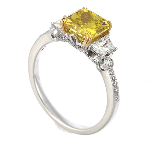 Ring in 18k gold with radiant-cut yellow diamond center by Supreme Jewelry