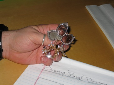 JCK art director Todd Gast holds a brooch from Diamonds For A Cure.
