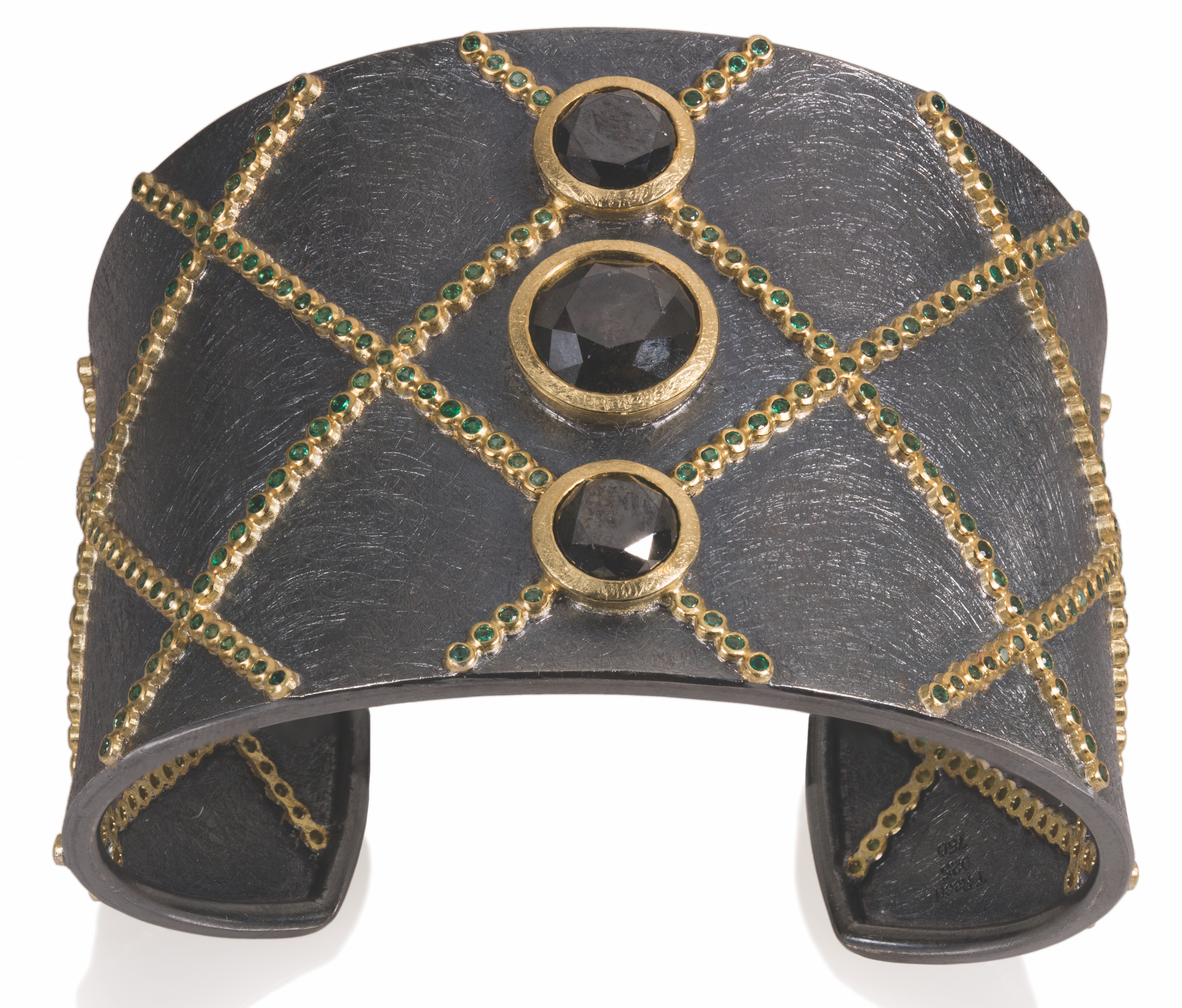 Todd Reed lattice cuff with black diamonds and emeralds | JCK On Your Market