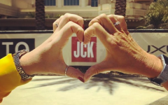 hands form a heart around the jck logo