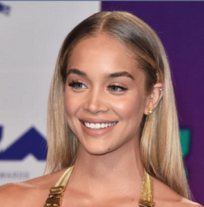 Jasmine Sanders in Harry Kotlar canary diamond earrings