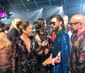 Erin Lim and Jared Leto in snake drop earrings