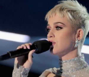 Katy Perry in Hueb diamond earrings