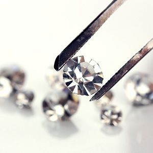 Examining one of a group of small diamonds