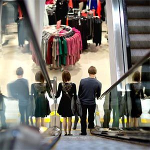 Mall shoppers on a shopping center escalator