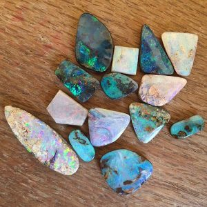 assortment of Australian opals on a table