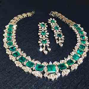 Emerald and diamond necklace and earrings set by Shruti Sushma