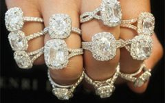 multiple diamond rings on each of four fingers