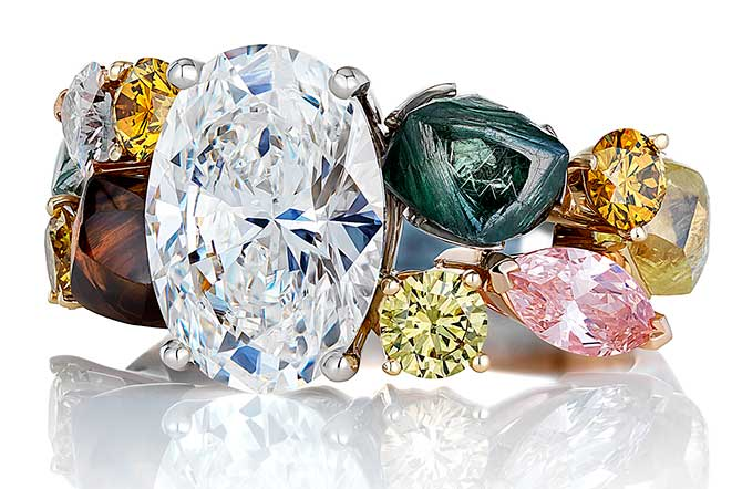 De Beers ring with rough and polished diamonds