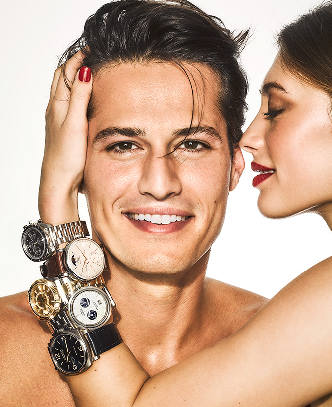 man wearing stack of watches