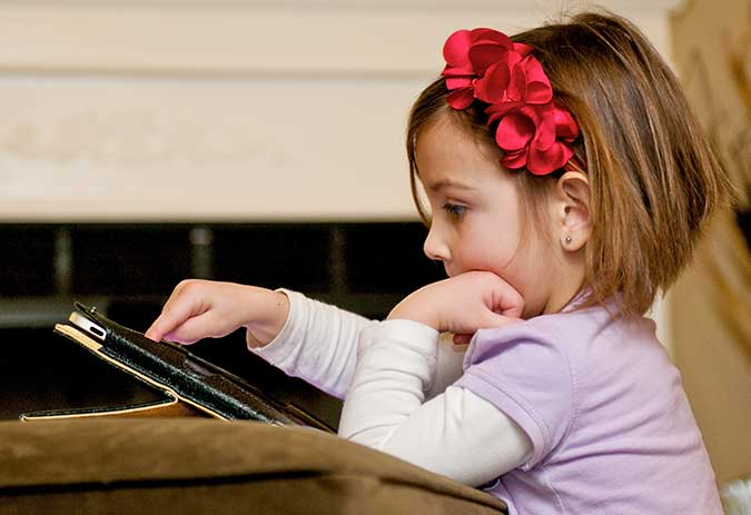 child with tablet