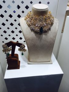 Diamond and emerald necklace and earrings on 18K gold by Sawansukha Jewellers