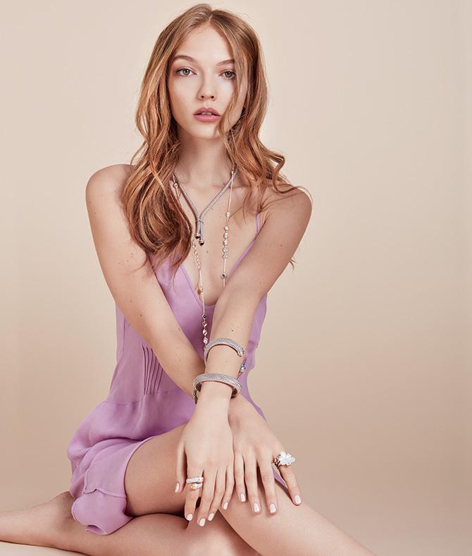 model in purple dress with silver jewelry