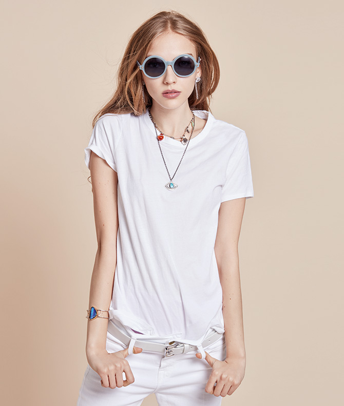 model in sunglasses with silver jewelry