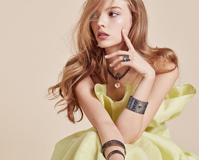 model in yellow dress silver jewelry