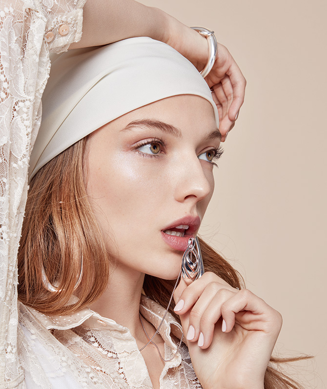 model with headwrap and silver jewelry