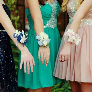 Prom goers with corsages via Pixabay