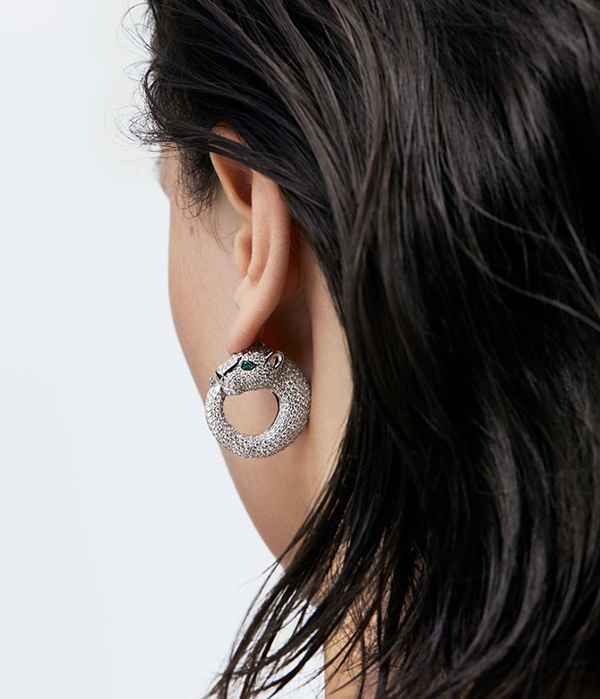 model with panther diamond earring