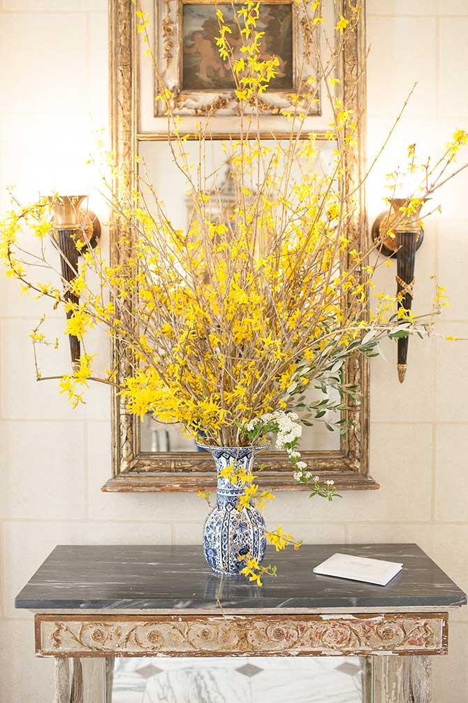 Forsythia branches in Delft vase