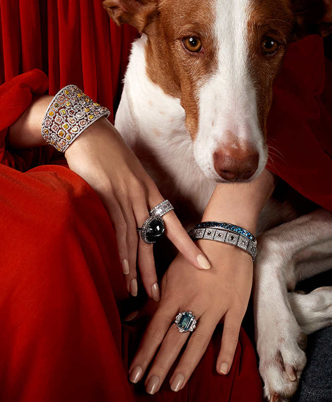 woman in deco jewelry and dog