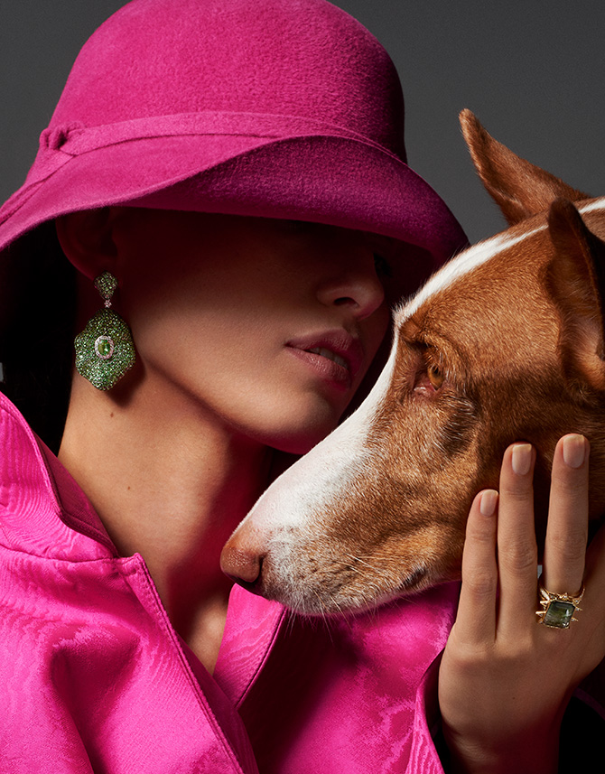 woman in green earrings and dog