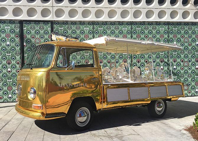 alexis bittar gold bus