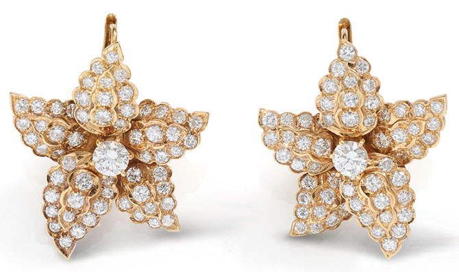 beneficial estate star earrings
