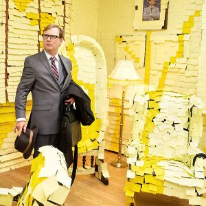 guy in room of postits