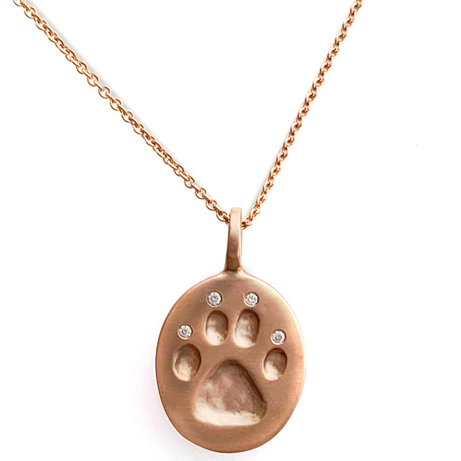 Judi Powers diamond Paw for a Cause pendant
