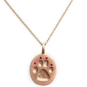 Judi Powers ruby Paw for a Cause pendant
