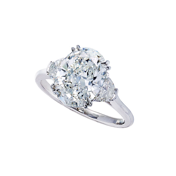 Wempe oval cut three stone diamond engagement ring