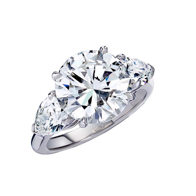 Wempe round diamond three stone engagement ring
