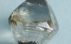 Coated synthetic moissanite