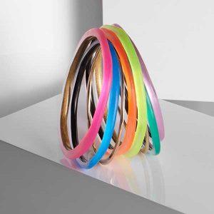 Alexis Bittar neon bracelet stack