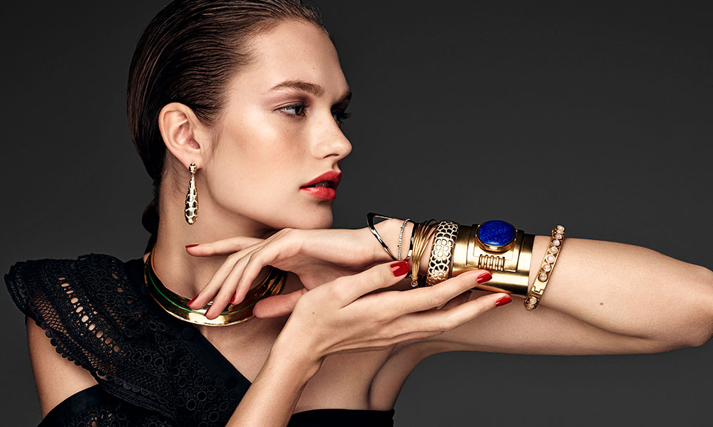 model in thick gold bracelets