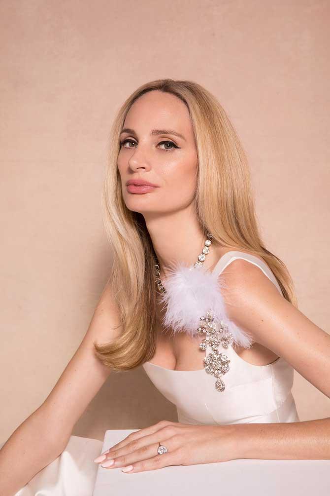 Lauren Santo Domingo in Christies jewelry