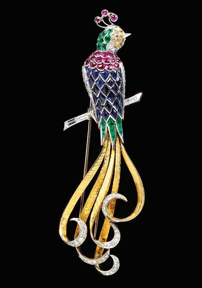 Bird brooch in gemstones and diamonds