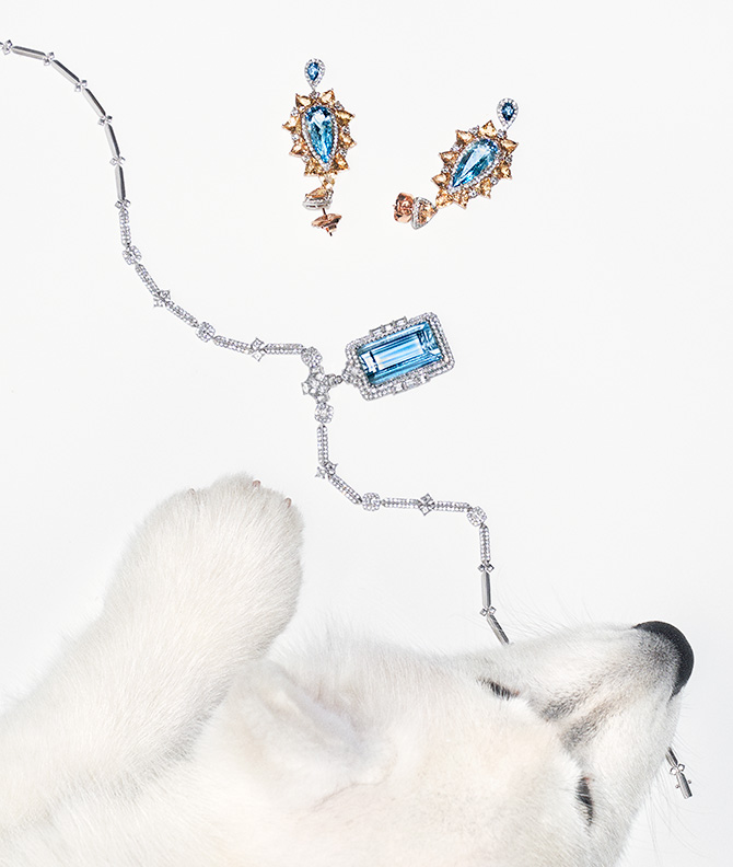 Dog with aquamarine pendant and earrings