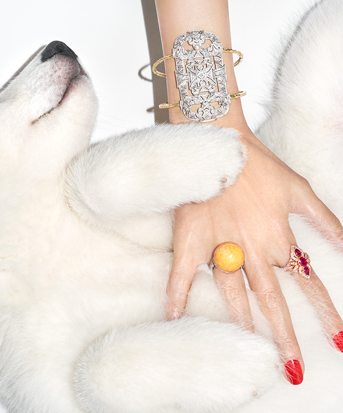 Woman petting dog with diamond bracelet and melo pearl