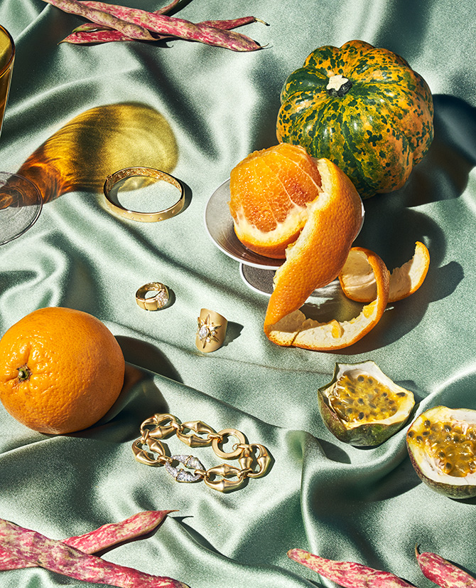 gold jewelry and oranges