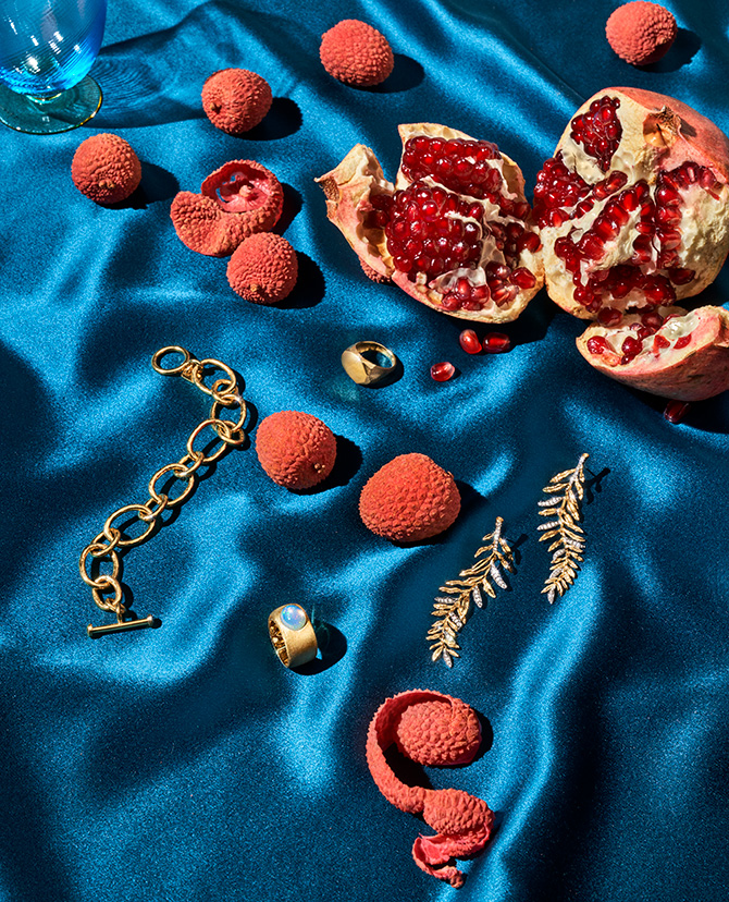gold jewelry and pomegranates